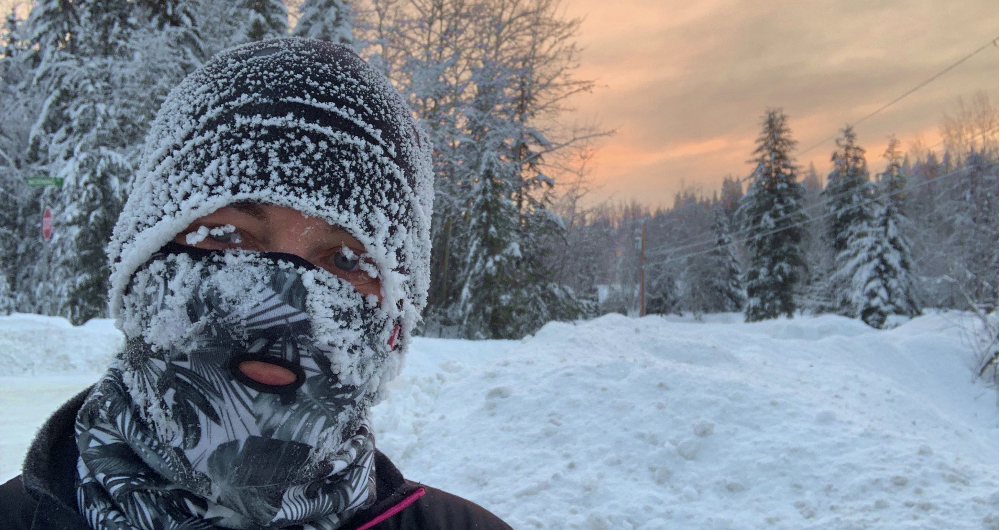 Woman in winter running gear with frost on face
